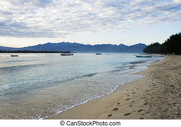 Beach of Trawangan island at morning, in Gili island,...