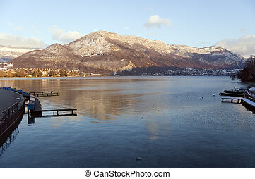 Lake Annecy at sunset - Lake Annecy and snowed mountains at...
