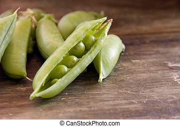 Shelled peas on a farm table - Shelled peas freshly picked...