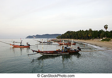 Long-tails boats in Thailand - Long-tails boats at sunrise...