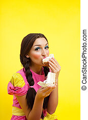 Young woman eat two cake - pin-up doll style - Happy girl...