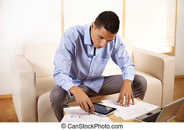 businessman using a Tablet PC - Portrait of a young...