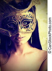 brunette in mask - Shot of a sexy woman in a mask over...