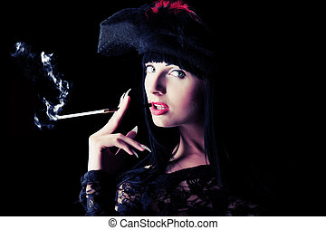 smoking lady - Shot of a sexy woman in erotic lingerie over...