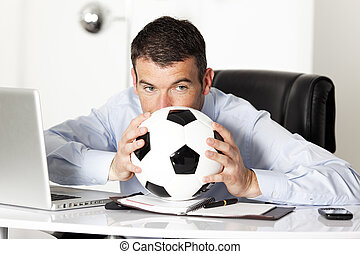 man with ball in office