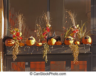 Halloween decoration - pumpkins on the ledge decorated with...