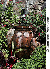 terracotta water container in garden - terracotta water...
