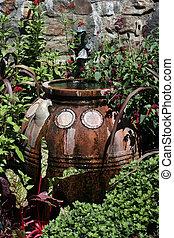 terracotta water container in garden - terracotta water...