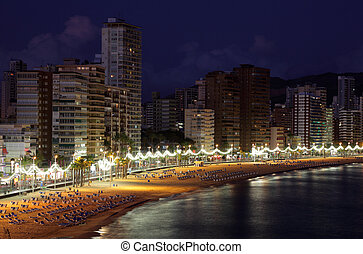 Beach of the Mediterranean resort Benidorm at night,...