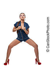 Sexy girl posing in jeans dress isolated