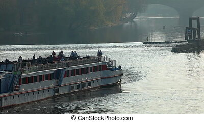 Pleasure boats move on vltava river in Prague