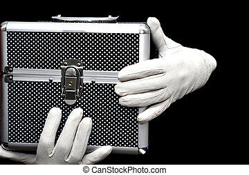 Magic box - White gloves and metallic suitcase isolated on...