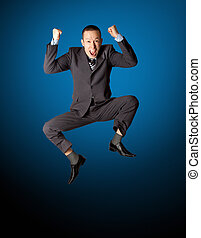 Happy businessman jumping in air isolated on white...