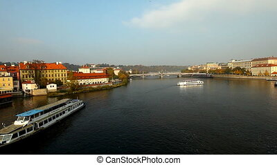 Pleasure boats move on river - view from karlov bridge,...