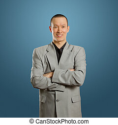 asian male in suit - asian male businessman in suit, looking...