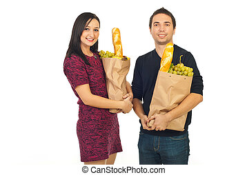 Happy couple with shopping food
