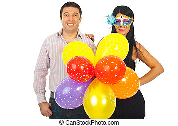 Happy couple with balloons at party