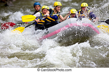 boat whitewater rafting - Group of people whitewater rafting...