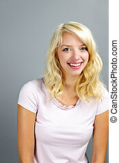 Happy young woman smiling - Portrait of smiling young blonde...