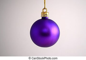 Purple Christmas ball - A hanging purple Christmas ball on...