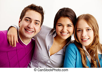 Happy friends - Portrait of attractive friends looking at...