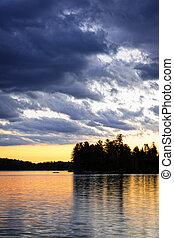 Dramatic sunset at lake