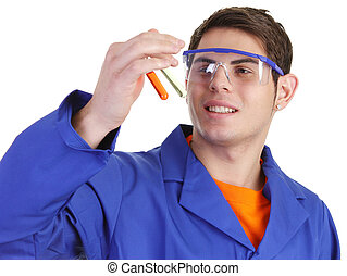 Lab worker - A lab worker looking at test tubes