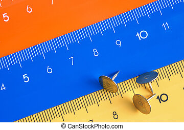 Rulers - Colour rulers with pushpins, a close up