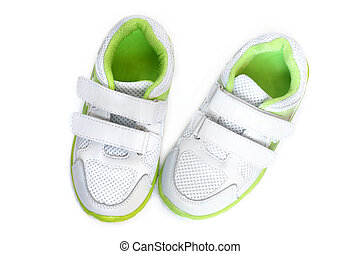 Childs sport shoes on a white background