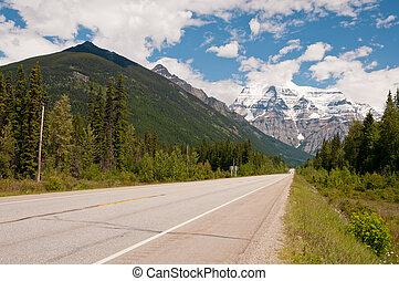Majestic snowy mountain - Scenic drive along long stretch of...