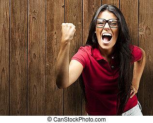 woman win gesture - portrait of yougn woman win gesture...