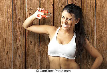 sporty young woman - portrait of sporty young woman doing...