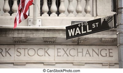 Wall Street - Street sign for Wall Street in front of the...