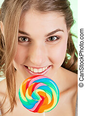 Teenager girl with lollipop - Portrait of smiling teenager...