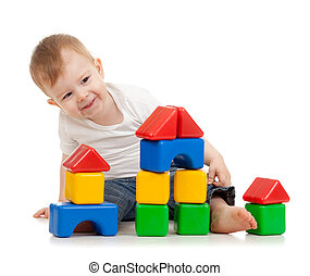 little boy with building blocks