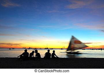 Boracay Island in Philippines - Boats near the coast of the...