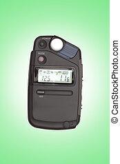 Digital flashmeter, isolated on green backrgound
