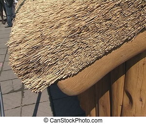 Roof of the house made of straw.