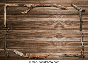 Stick frame on old wooden background