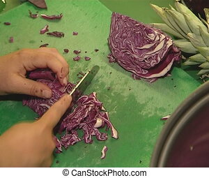 Red cabbage cut with knife.