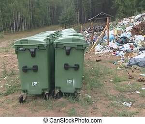 Bins near forest and lot of garbage - Bins near forest and a...
