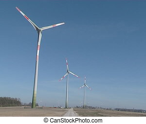 Three windmills produce electricity