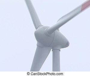 Windmill near power transformer. Green power supplies to...
