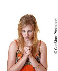 Teen girl praying.