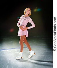 Figure Skater on Ice in Spotlight - A Figure Skater on Ice...