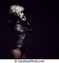 gorgeous blonde in lace dress, isolated on black, studio...