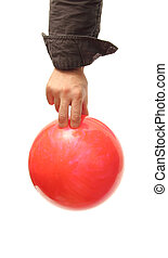 bowling ball - closeup of a hand holding a bowling ball over...