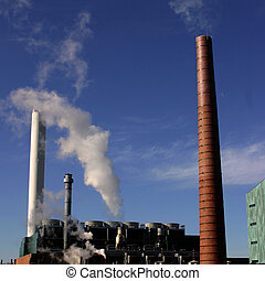 Smoke Stacks - Smoke / Steam Stacks in from of a blue sky in...