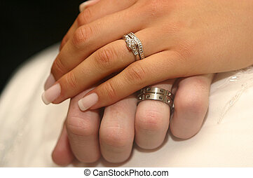 Wedding Rings - A closeup of a couples rings on their...