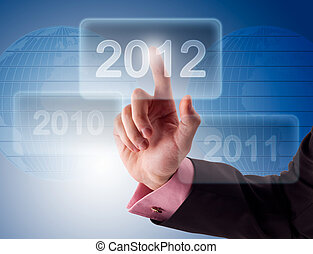 Businessman pressing button New Year
